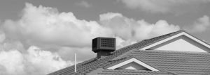 Evaporative cooler on a house roof